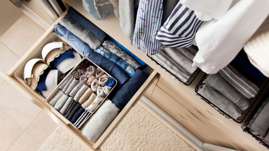 drawer and closet with organized clothes