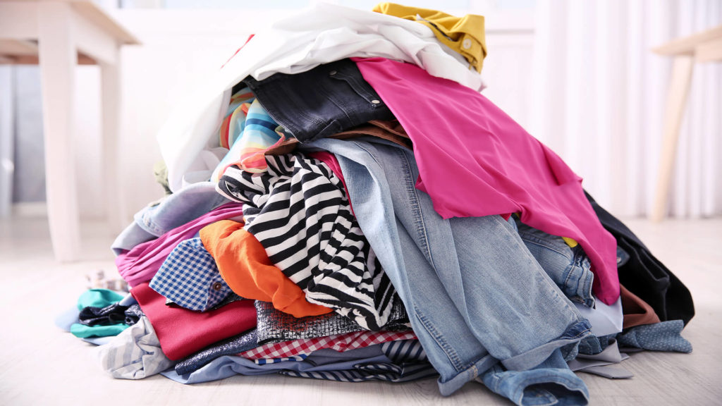 pile of used clothes on the floor