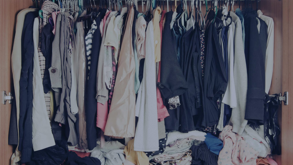 messy closet full of clothes